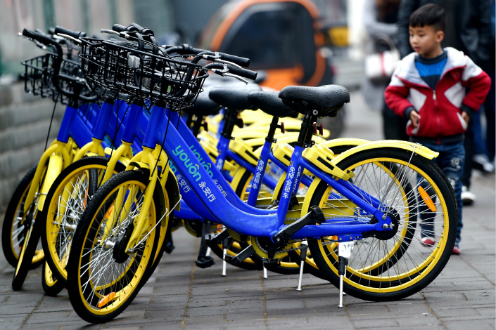Jiangsu Youon's shared bikes await riders on a street in Luoyang, Henan province. Photo: VCG