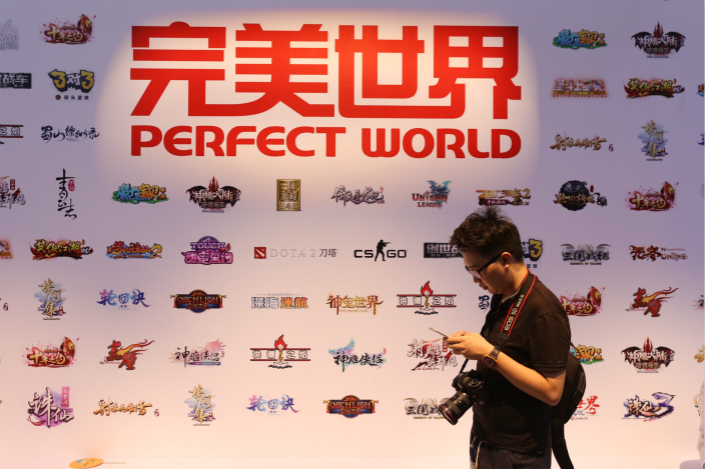A vistor walks past Perfect World's stand at the 15th China Digital Entertainment Expo in Shanghai on July 30. Photo: IC