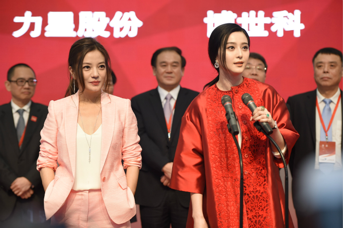 Actresses Zhao Wei (left) and Fan Bingbing attend the listing ceremony of Zhejiang Talent Television and Film Co. Ltd. at the Shenzhen Stock Exchange in February 2015. Photo: VCG