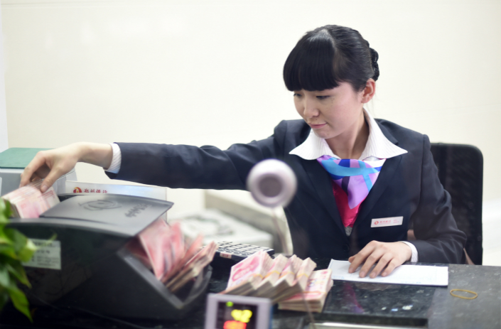 The China Banking and Insurance Regulatory Commissionto has introduced a new regulation to curb lending to companies that are taking on more debt than what they can repay. Photo: VCG