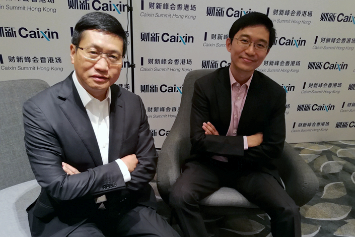 Zhongan CEO Jeffrey Chen (left) and President Wayne Xu on the sidelines of Caixin Summit Hong Kong on June 8. Photo: Yang Ge/Caixin