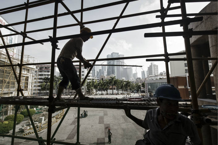 Workers construct scaffolding at a construction site Shenzhen on Sept.  20. Photo: VCG