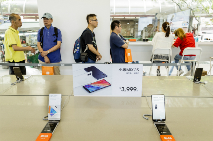Smartphones are displayed at a Xiaomi store on Nathan Road, Hong Kong on May 7. Photo: VCG