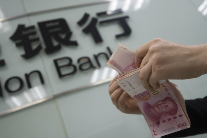 While the country's big four state-owned banks have been rigorously defining loans as non-performing, smaller lenders including city and rural commercial banks have been far less stringent. Photo: VCG