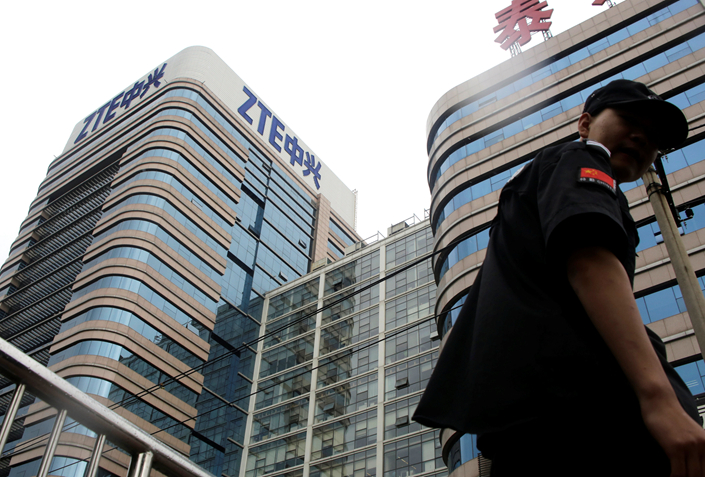 A security guard walks past a building of ZTE Beijing research and development center in Beijing