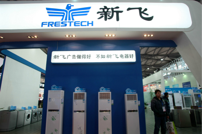 People visit the Frestech booth at an exhibition in Shanghai in March 2012. Photo: IC