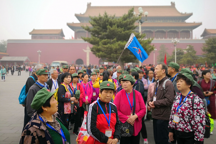 A tour group of senior citizens visit in the Forbidden City in Beijing on May 12. Photo: Deng Jing