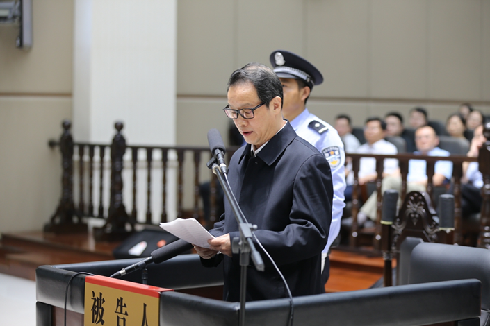 Xiang Junbo, former chairman of the China Insurance Regulatory Commission, addresses a court in Changzhou, Jiangsu province, during his trial for graft Thursday. Photo: Changzhou Intermediate People's Court