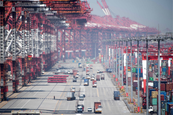 Cargo is loaded and unloaded at Yangshan Deep-Water Port in Shanghai on April 9. Photo: VCG