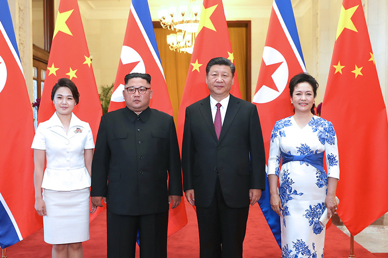 Xi Jinping (second from right) and his wife Peng Liyuan (right) meet with Kim Jong Un and his wife Ri Sol Ju at the Great Hall of the People in Beijing on June 19. Photo: Xinhua