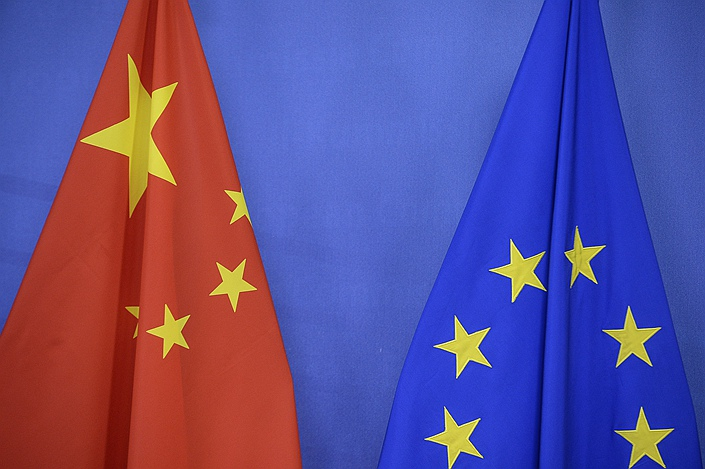 Chinese and European Union flags  at European Commission headquarters in Brussels