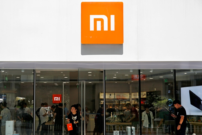 A shopper leaves a Xiaomi store in Beijing on Wednesday. Photo: IC