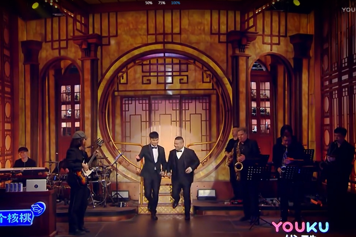 Actor Chen He and crosstalk comedian Yue Yunpeng hosted the first episode of SNL China, which aired Saturday on the online video site Youku. Photo: Caixin