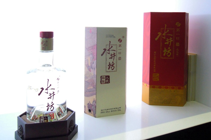 Bottles of Swellfun baijiu on display. After suffering losses in 2013 and 2014, the company returned to profits in 2015 and increased its profitability in subsequent years. Photo: VCG