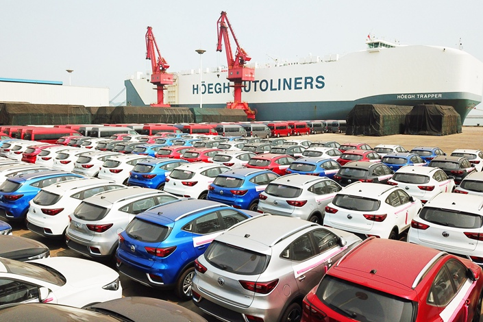 Chinese-made cars wait to be loaded on to a ship that will take them to the U.K. in Jiangsu province's Lianyungang port on June 8. Photo: VCG