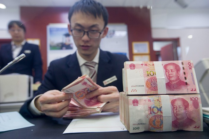 As the economy enters a stage of high-quality development, the factors that pushed up financial leverage will undergo major changes, said central bank advisor Liu Shijin. Photo: VCG