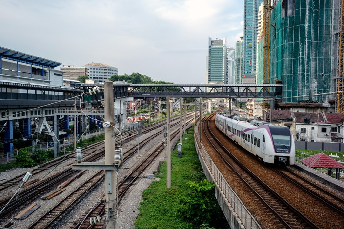 A high-speed train runs from downtown Kuala Lumpur to Kuala Lumpur International Airport in Malaysia in August 2016. Photo: VCG
