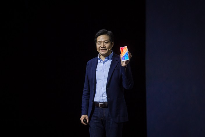 Xiaomi Corp. CEO and co-founder Lei Jun presents the company's Mi Mix 2S smartphone at a launch even in Shanghai on March 27. Photo: VCG