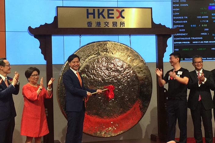 Xiaomi Corp CEO Lei Jun poses at the stock market opening at the Hong Kong Exchange on Monday. Photo: Wei Yiyang/ Caixin