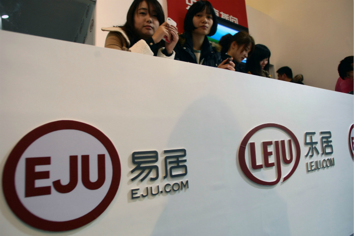 A booth of Eju.com (E-House China) and Leju.com is seen at the Shanghai Spring Real Estate Trade Fair in March 2012. Photo: IC