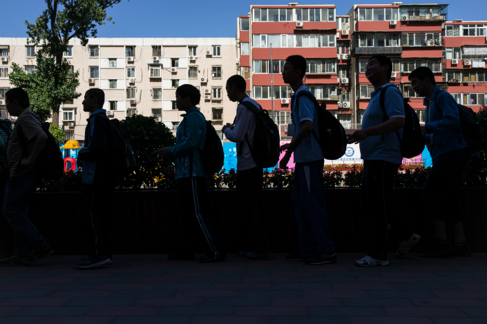 Middle school students return from school in Beijing in May. Photo: VCG