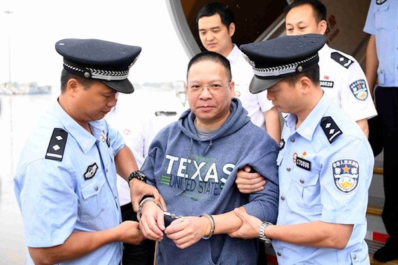 Xu Chaofan (center) was repatriated to China on July 11. Photo: CCDI/Xu Menglong