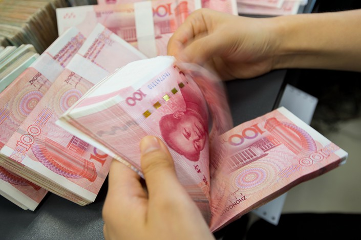 China is expected to allow financial institutions to set their own agenda for complying with new asset-management rules before a grace period expires at the end of 2020. Photo: IC