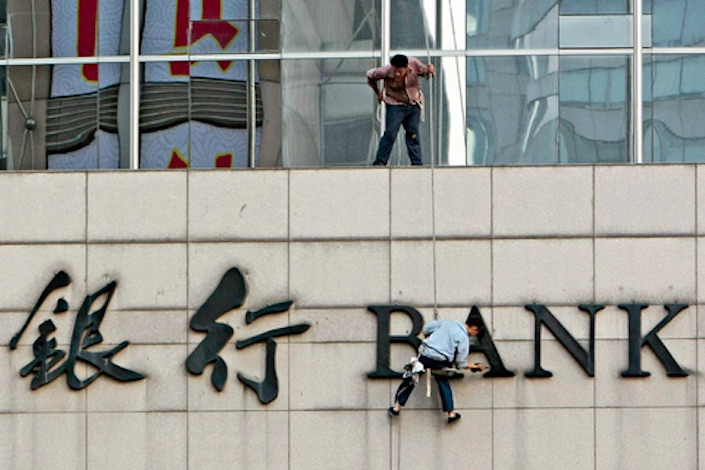 The China Banking and Insurance Regulatory Commission has issued fines to 798 banking institutions in the first half of 2018. Photo: VCG