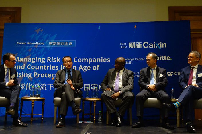 Experts attending a Caixin-sponsored BRICS roundtable in Johannesburg on Tuesday debate how emerging economies should manage risks to companies in an age of rising protectionism. Photo: Leng Cheng / Caixin