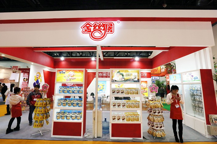 Shanghai Golden Monkey Food Co. Ltd. hosts a stand at a world food fair in Beijing in November 2014. Photo: VCG