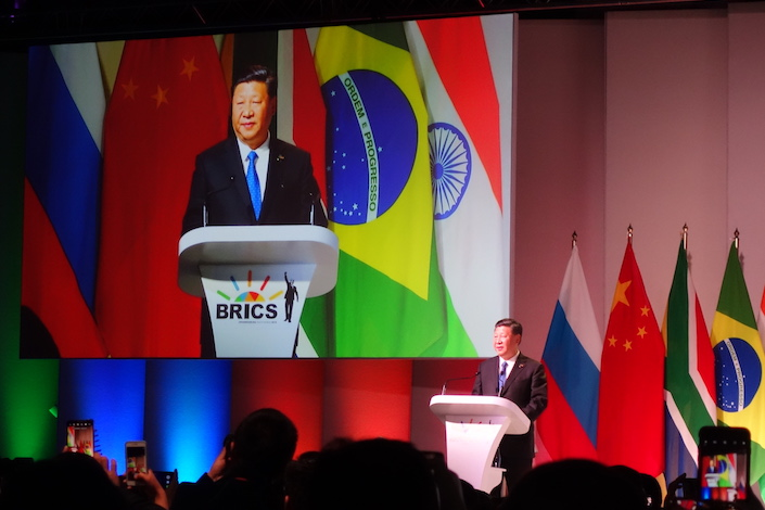 President Xi Jinping addresses 1,200 business leaders and government officials at the BRICS Business Forum in Johannesburg, South Africa, on Wednesday. Photo: Leng Cheng/Caixin