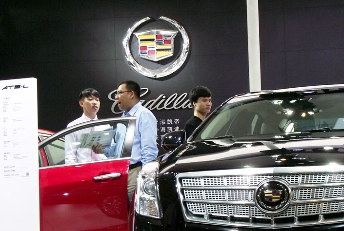 Consumers examine a couple of models at a Cadillac dealership in Nanjing, East China's Jiangsu province, in July 2017. Photo: IC