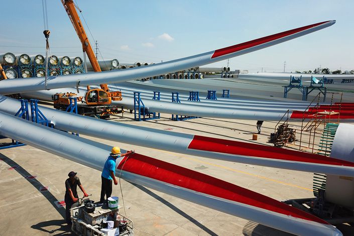 Workers test out wind turbine blades as they leave the factory of a wind power equipment manufacturer in East China's Jiangsu province. Photo: VCG