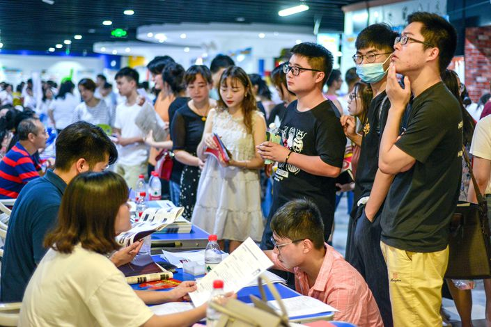 Job seekers attend a jobs fair in Huzhou, Zhejiang province, on July 28. Photo: VCG