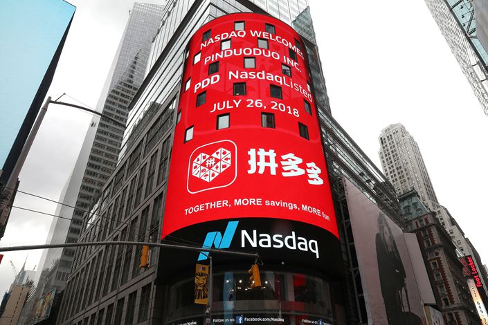 A message on a video screen in New York's Times Square welcomes Pinduoduo to the Nasdaq Stock Market on July 26. Photo: VCG
