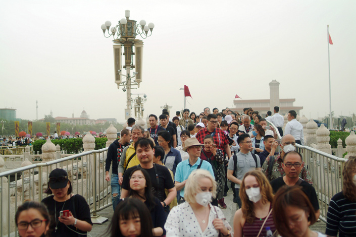 Tourists flock into the Forbidden City from Tiananmen Square in Beijing in May. Photo: Wu Gang/Caixin