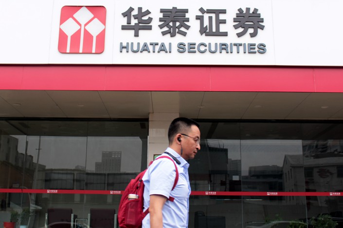 A pedestrian passes by a branch of Huatai Securities in East China's Jiangsu province on May 27. Photo: IC