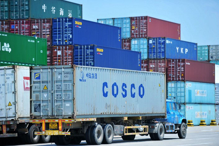 A truck transports a shipping container at the Port of Qingdao in East China's Shandong Province on July 6. Photo: IC