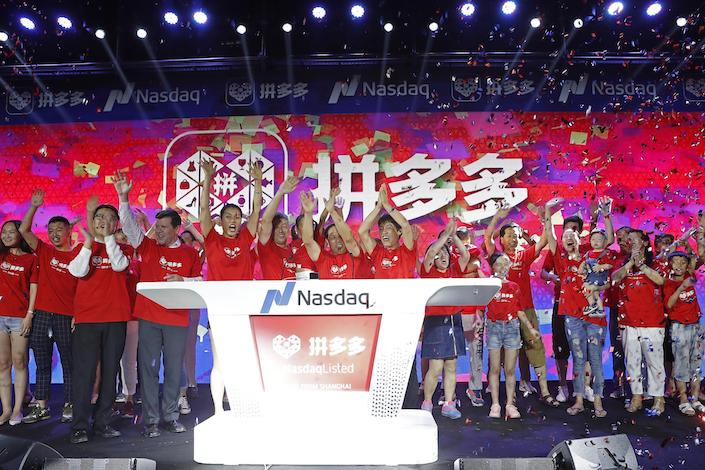 Pinduoduo employees gather in Shanghai to celebrate the company's Nasdaq debut on July 26. Photo: VCG