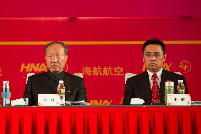 HNA's co-founders Chen Feng (left) and Wang Jian (right) attended an internal meeting in 2013. Photo: VCG