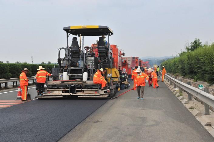 Repair work is underway on the expressway in jinan, shandong province, July 02, 2018.