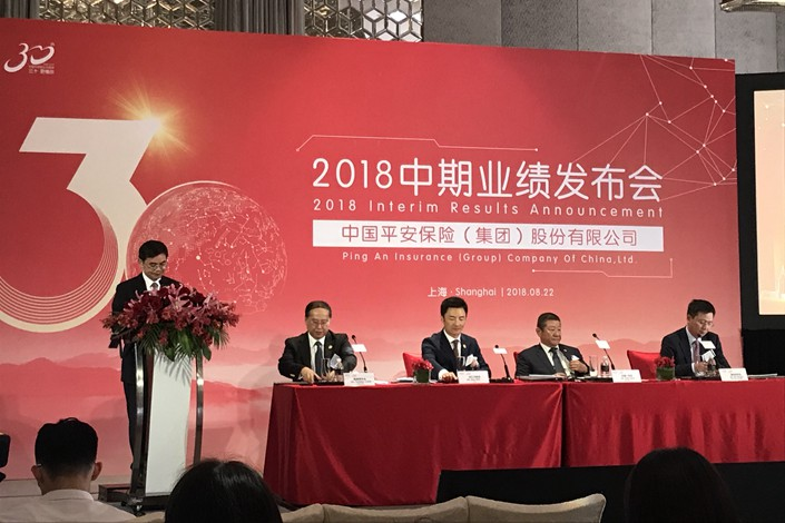 Executives from Ping An Insurance Group hold a media conference on Wednesday to announce the company's better-then-expected profits. Photo: Leng Cheng/Caixin
