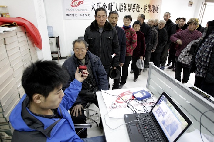 Residents in Shangqiu, Henan province, queue up to set up social insurance accounts to claim benefits. Photo: VCG