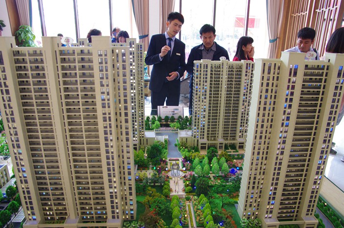 Homebuyers visit a housing sales office in Rizhao, Shandong province, on April 30. Photo: IC