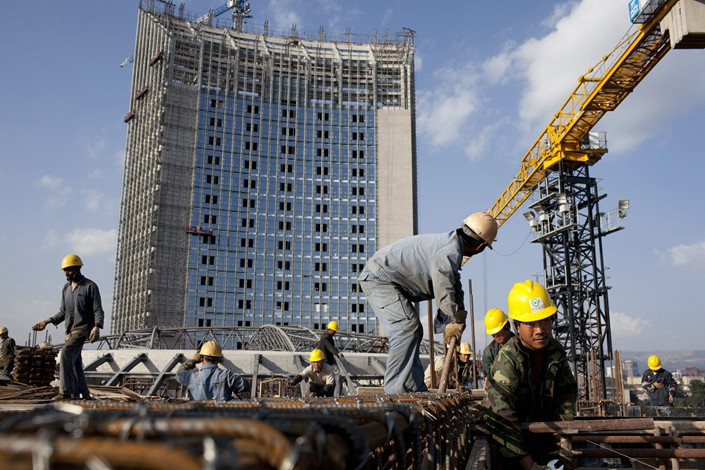 Chinese construction workers build the since-completed African Union Headquarters in Addis Ababa, Ethiopia. Photo: VCG