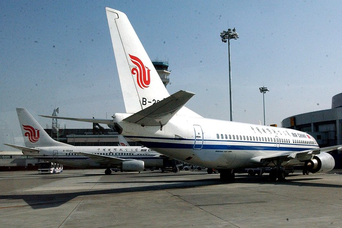 An Air China jetliner sits on the tarmac of Beijing Capital International Airport. Photo: VCG