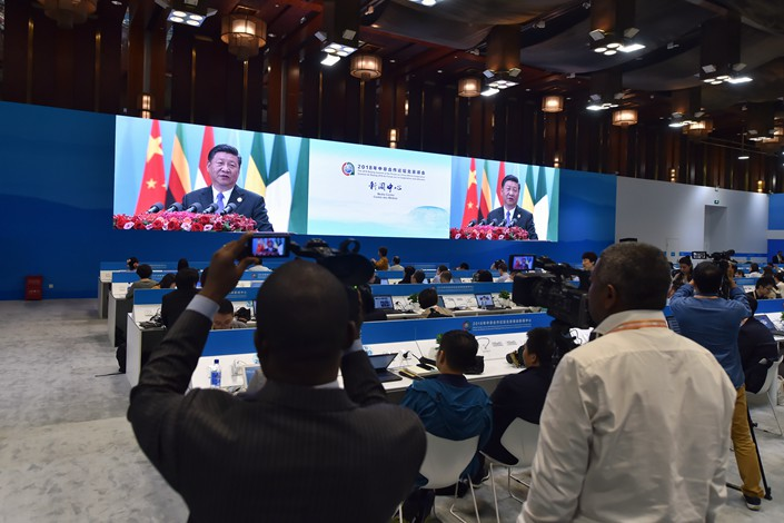 Reporters from China and around the world gather in the press center of the Forum on China-Africa Cooperation summit in Beijing on Sept 3. to watch Chinese President Xi Jinping deliver a keynote speech. Photo: IC