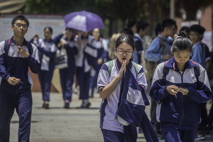 Middle school students in Guangzhou, Guangdong province leave an exam hall after taking the High School Entrance Exam. Photo: VCG