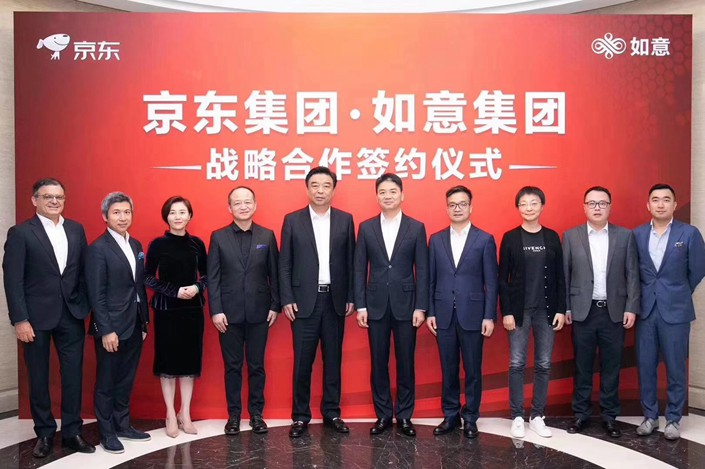 JD.com Inc. founder and CEO Liu Qiangdong (center right) appeared in public at his company's Beijing headquarters on Tuesday. Photo: JD.com