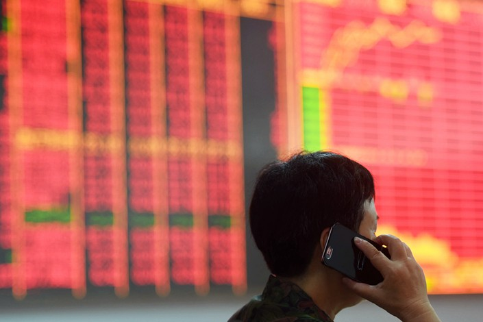 An investor talks on his phone at a brokerage in Hangzhou, Zhejiang province on July 24. Photo: IC
